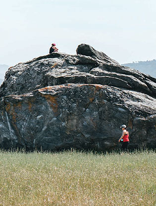 Hikers at Turtle Rock, Ring Mountain Preserve