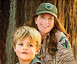 Naturalist and child in redwood forest