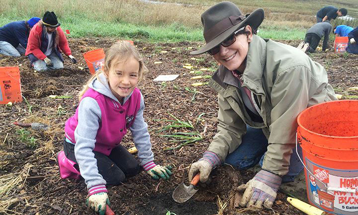 Mother and daughter planting at Creekside