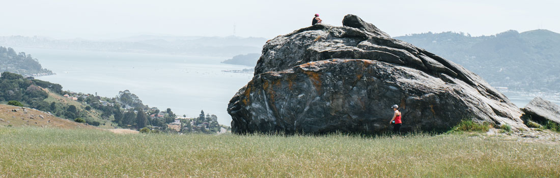Visitors exploring Turtle Rock on Ring Mountain
