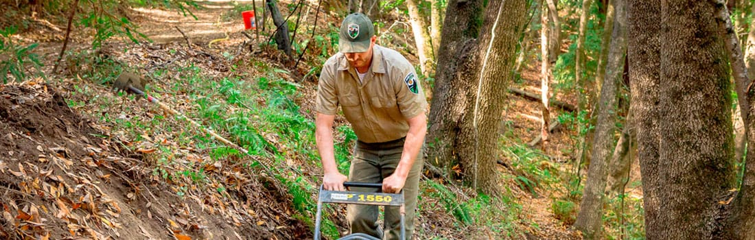 Open space ranger working on a trail