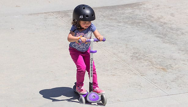 Young girl on scooter