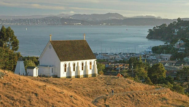 White church overlooking the Bay