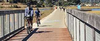 Cyclists riding over new pathway bridge deck