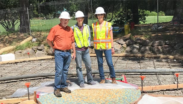 Landscape architecture team in hard hats next to labyrinth construction