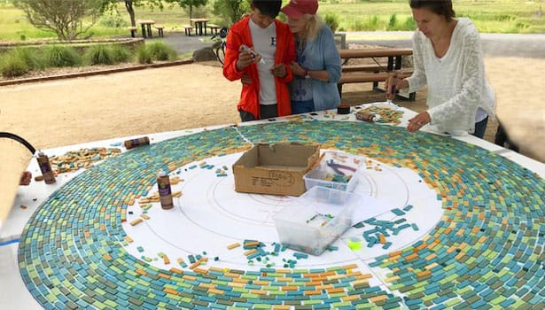 Community volunteers creating the labyrinth mosaic