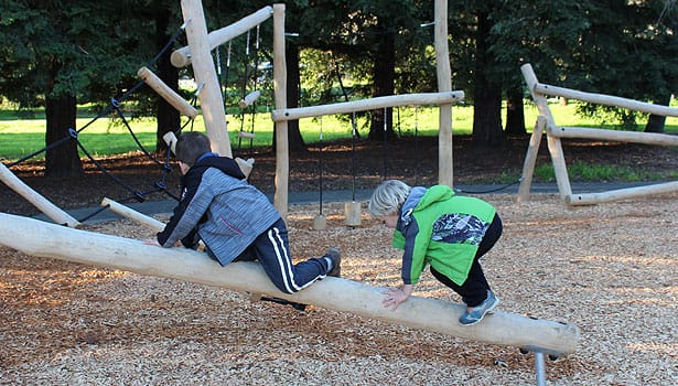 Two boys climbing at the playground