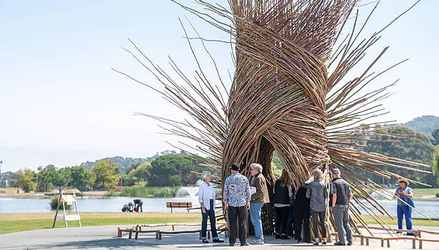 People gathering around the Spirit Nest at Lagoon Park