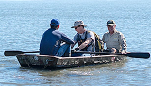 Parks staff and volunteers in the rowboat to Kent Island