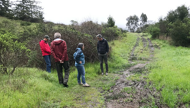 Community group on site reviewing wet conditions at School Trail
